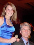 Alison Coyle at the USDF National Symposium shortly after receiving her Bronze medal, with her dad David Coyle