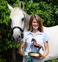 """Alison and her pony """"Stormy Weather"""" with the Seldom Scene trophy"""